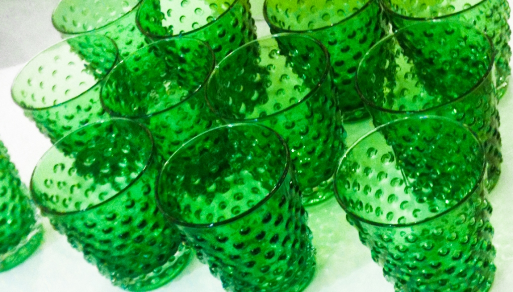 Green glasses on a table